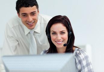 Latin businessman helping his colleague
