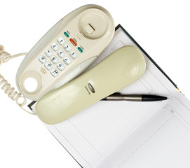 Office phone, calendar and pen