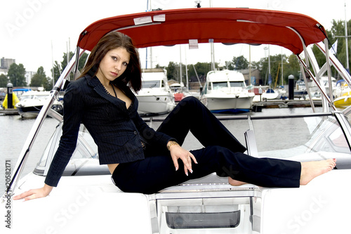 Beautiful sexy brunette relaxing on a ship