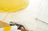 Yellow hardhat on drawings poster