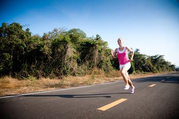 Blond woman running cross country