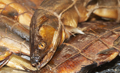 Variety of smoked fish in cooled market display