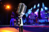 Vintage Microphone With Concert in Background