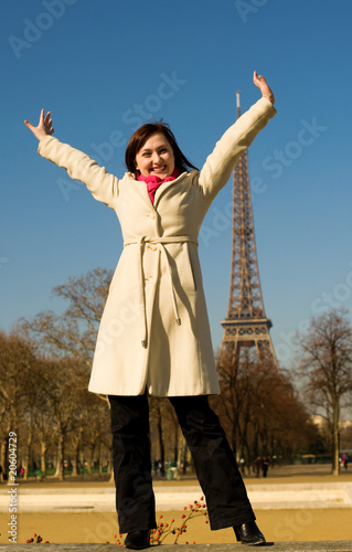 Happy beautiful woman having fum in Paris