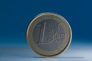 1 euro coin on blue gray