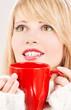 happy teenage girl with red mug