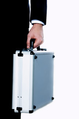 Businessman with metal suitcase