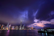 Hong Kong skyline at night, with dramatic sky.