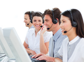 Cheerful business people talking on headset