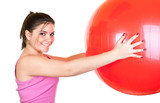 brunette girl in pink exercising with big red ball