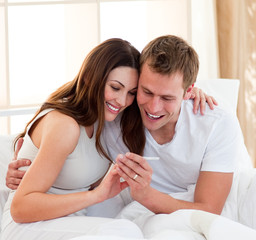 Joyful couple finding out results of a pregnancy test