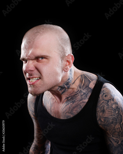 Tattooed Angry man with evil eyes