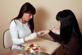 Manicurist treating customer at beauty salon poster