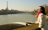 Happy beautiful woman in Paris on the Seine embankment poster