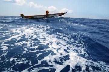 African motorboat in atlantic blue water