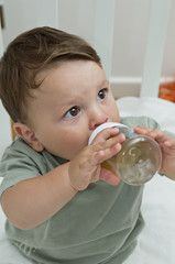 Baby boy drinking from bottle