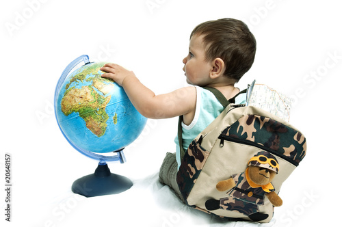 Baby boy with backpack and globe