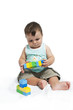Baby boy playing with building blocks