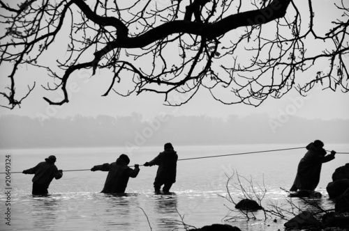 Fishermen in the water