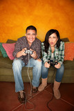 Hispanic Couple Playing Video game poster