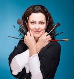 Stylist with make up brushes on blue background poster