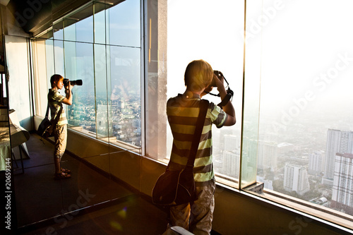 boy enjoying view across Bangkok skyline