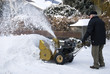 senior man with snowblower