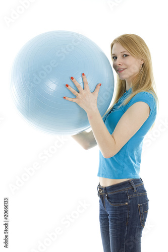 girl keeping blue ball isolated on white background