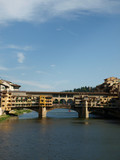 The Ponte Vecchio  over the Arno River, in Florence, Italy poster