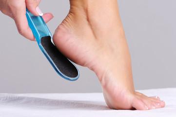 woman scrubbing  heel