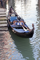 Gondola moored in a canal, Venice, Italy