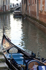 A Gondola in a canal, Venice, Italy