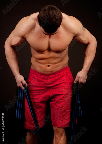 bodybuilder with  rope