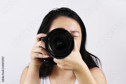 A female photographer with a DSLR camera