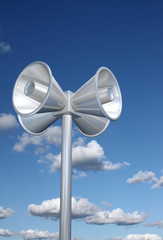Chromed loudspeakers with sky background