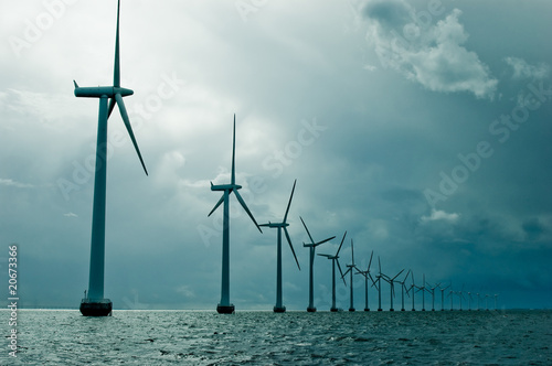 Windmills in a row on cloudy weather - 20673366