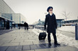 young pilot walking with baggage in Kastrup airport