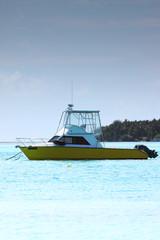 A single boat anchored off an island at Maldives