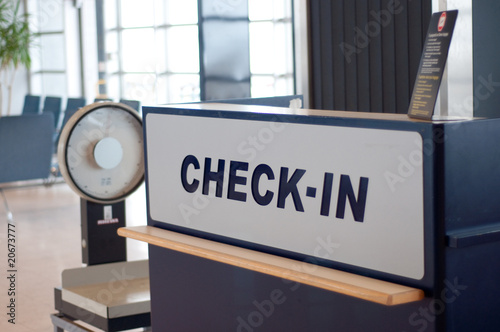 check-in sign at the airport with weights