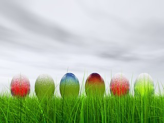 High resolution Easter eggs in grass over a blue sky