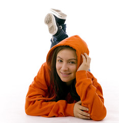 girl in orange sweatshirt with hood, leaning on palm head