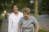 Physical therapist laughs with a patient poster