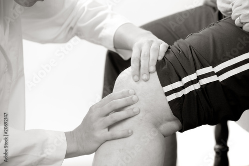 physical therapist checks a knee