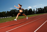dynamic image of a young woman running on a track