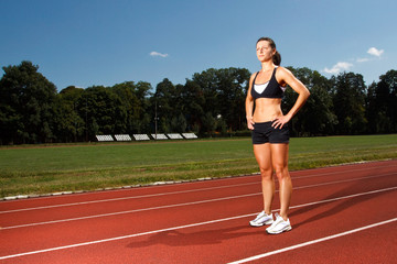 young woman on a running track