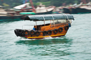 boat cruise with traditional wooden junk in Aberdeen, Hongkongs