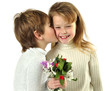 Little boy giving flowers to the girl