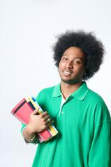 black student holding textbook