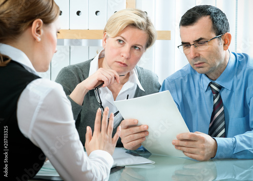 mid-adult couple meeting with financial planner
