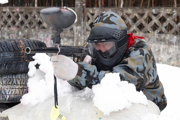 Paintball player in shooting position